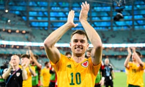 Aaron Ramsey of Wales celebrating with his supporters and teammates after winning against Turkey during the UEFA Euro 2020 Championship Group A match between Turkey and Wales on June 16, 2021 in Baku, Azerbaijan. (Photo by Marcio Machado/Getty Images)