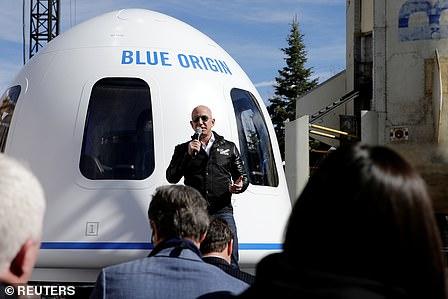 Jeff Bezos in front of Blue Origin's space capsule