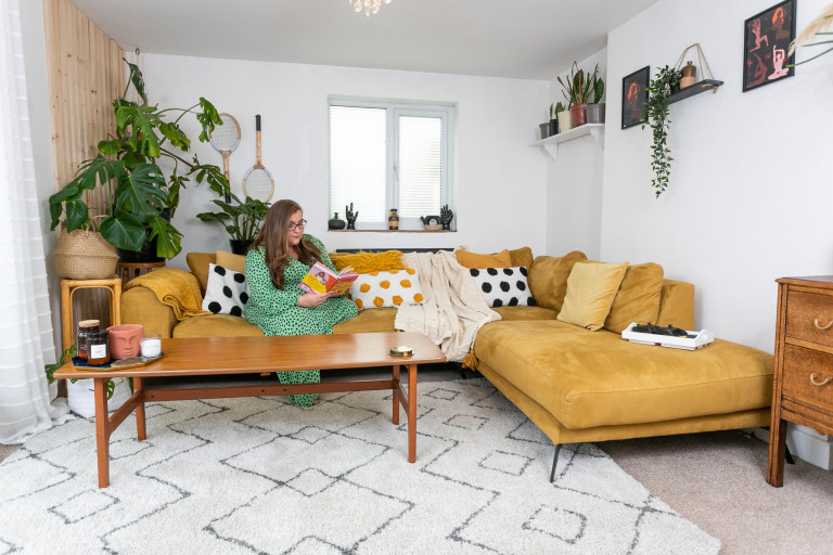 What I Rent: Jess, Wirral, Merseyside: Jess in the living room on a yellow sofa