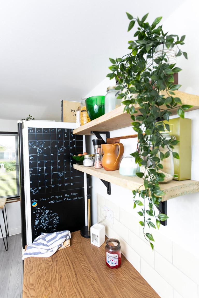 What I Rent: Jess, Wirral, Merseyside: fridge and chalkboard calendar in kitchen