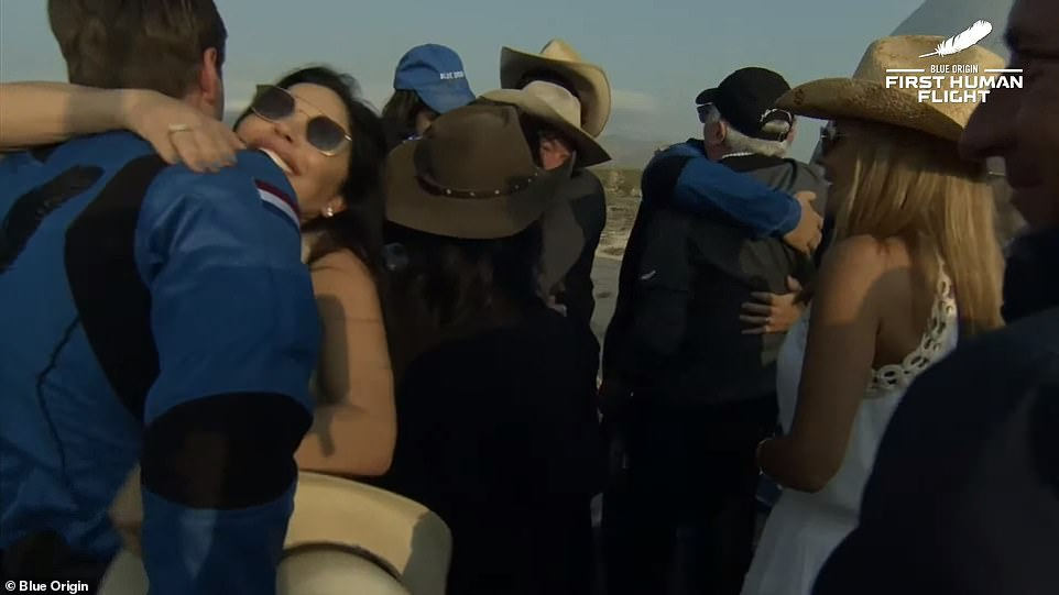 Daemen hugged his parents after landing before being given a hug by Bezos' girlfriend Sanchez (shown)