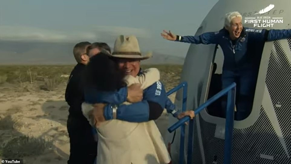 Jeff Bezos hugs his mother Jacklyn after returning to earth with his crew mates on Tuesday morning