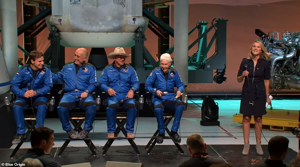 Oliver Daemen, Mark Bezos, Jeff Bezos and Wally Funk appear at a press conference on Tuesday morning after returning from space