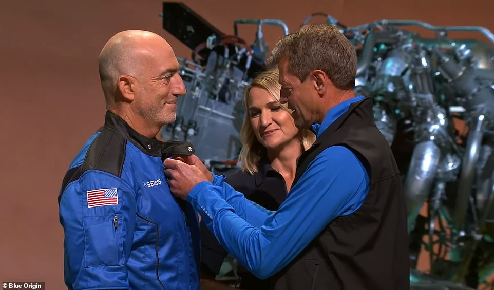 Mark Bezos, the Amazon founder's younger brother, receives his pin after the successful space flight on Tuesday