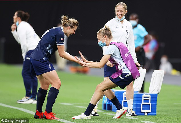 White celebrates with Team GB team-mate and substitute Leah Williamson on Wednesday