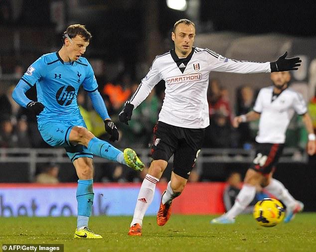 Vlad Chiriches defends against Fulham's Bulgarian striker Dimitar Berbatov back in 2013