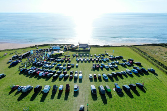 Story from Jam Press (Best Cinema) Pictured: The Wavelength drive-in cinema at Trebelsue farm, Watergate Bay in Cornwall. This is the most picturesque cinema in the world - and it's in the UK! An oceanfront drive-in cinema boasting incredible sea views has opened in Cornwall - and you can now watch your favourite surf-inspired movies with spectacular scenery of the coastline. The Wavelength drive-in cinema has returned to Trebelsue farm, Watergate Bay in Cornwall this summer, screening some of the best movies with a beautiful backdrop. The outdoor cinema overlooks spectacular views of the Atlantic Ocean, perfect for family get-togethers, friend meetups or a romantic date night watching the sunset in the distance. The theatre will open from 16 July to 5 September, offering a wide selection of classics, surf movies and family-friendly films to suit viewers of all ages. Some of the movies include Jurassic Park, The Greatest Showman, Grease and Top Gun, with both day and evening showtimes. There will also be screenings of surf films for all-time movie buffs, including Blue Juice and Point Break, inspired by the Cornwall coastline. The action thriller ???Jaws??? will also be playing, sending shivers down your spine with the ocean just a few feet away. Tickets cost ??26 per car and ??6 for each passenger. They are also offering picnic passes for those who wish to park their car and sit outdoors, costing ??7 per person. There will be live music entertainment and a selection of local eateries providing food and drinks to purchase. ENDSStory from Jam Press (Best Cinema) Pictured: . This is the most picturesque cinema in the world - and it's in the UK! An oceanfront drive-in cinema boasting incredible sea views has opened in Cornwall - and you can now watch your favourite surf-inspired movies with spectacular scenery of the coastline. The Wavelength drive-in cinema has returned to Trebelsue farm, Watergate Bay in Cornwall this summer, screening some of the