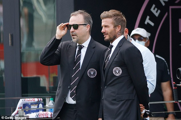 Beckham (right) may well have to make a very tough judgement call on his close friend Neville