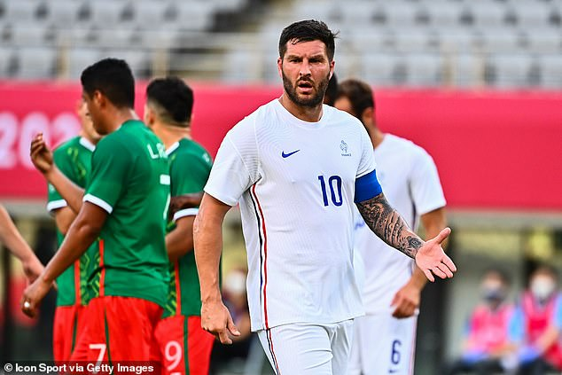 France's Pierre-Andre Gignac looks on in dismay as his side are beaten 4-1 by Mexico in Tokyo