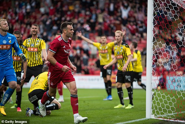 Andy Considine (front) grabbed the opener at Pittodrie with a close-range header