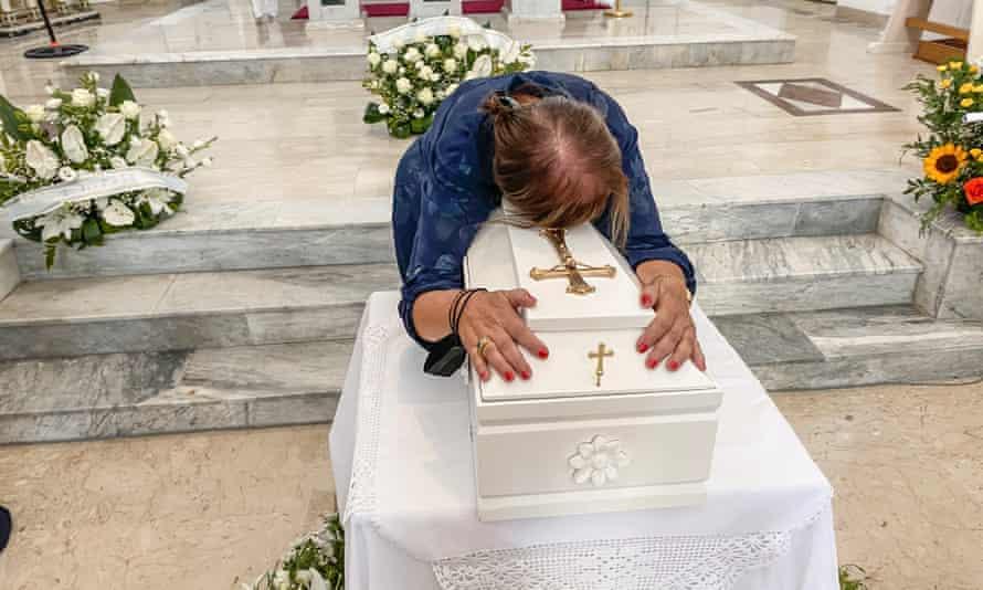 Maria Lucia Mantione embraces Lucia's coffin