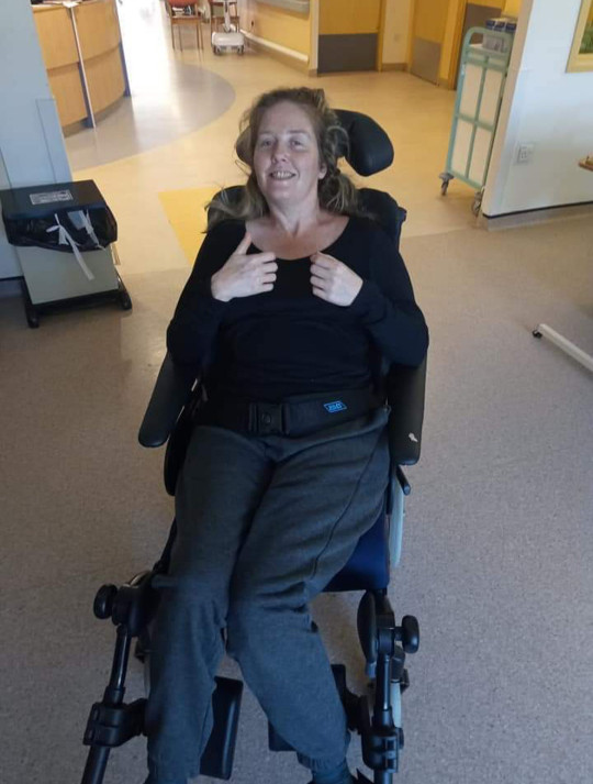 PIC FROM Kennedy News and Media (PICTURED: SOPHIE RODGERS (44) FROM RIPON, NORTH YORKSHIRE, WHO WAS PARALYSED FROM THE NECK DOWN AFTER FALLING OUT OF BED, WHILE SHE WAS IN THE HIGH DEPENDENCY UNIT WHEN SHE WAS PARALYSED APART FROM HER ELBOWS AND FOREARM) A mum was PARALYSED from the neck down after falling out of BED while messing around with her hubby. Sophie Rodgers said she was 'mucking about' with husband Guy Rodgers, 53, back in August 2019 when she attempted to bunny hop over him but 'misjudged' her jump, fell out of their double bed and knocked herself out. When the 44-year-old woke up the next morning she 'couldn't move anything' and was dashed to James Cook University Hospital, Middlesbrough, where she was told she'd 'probably never walk again'. DISCLAIMER: While Kennedy News and Media uses its best endeavours to establish the copyright and authenticity of all pictures supplied, it accepts no liability for any damage, loss or legal action caused by the use of images supplied and the publication of images is solely at your discretion. SEE KENNEDY NEWS COPY - 0161 697 4266
