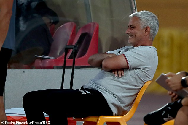 Roma boss Jose Mourinho looks on from the sidelines with a smile during the encounter