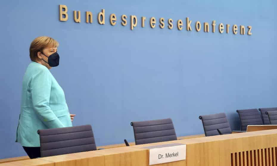 Angela Merkel arrives for her annual summer news conference in Berlin.