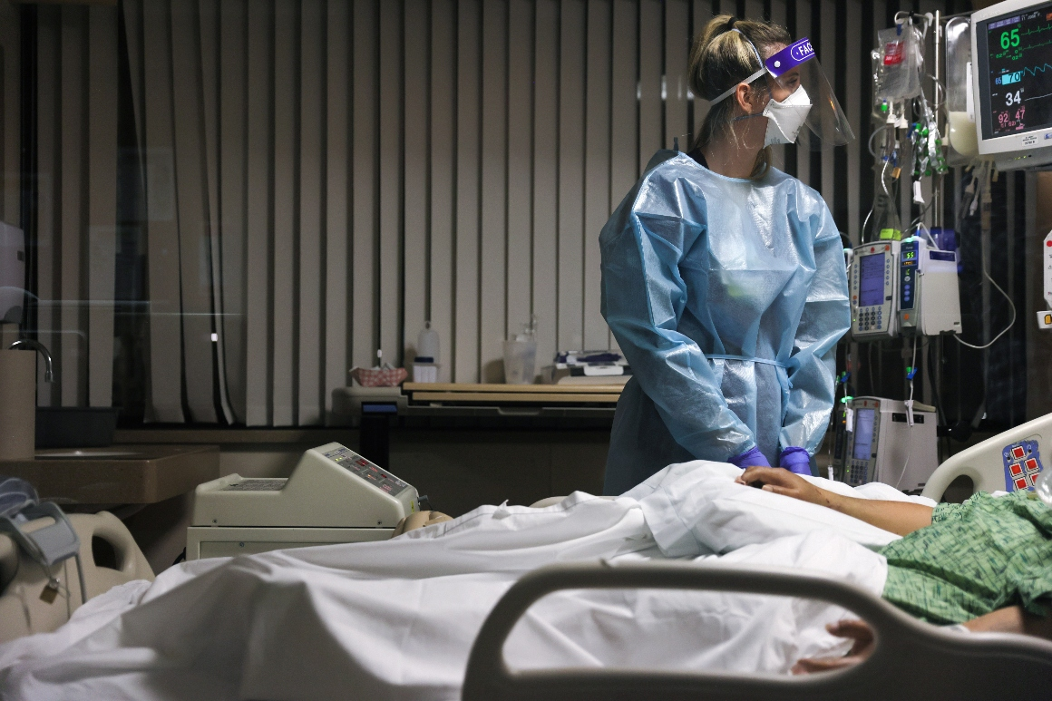 Registered nurse Tricia Cook cares for a Covid-19 patient.
