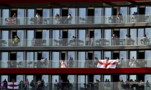People watch the game from the balconies of a hotel overlooking Old Trafford.