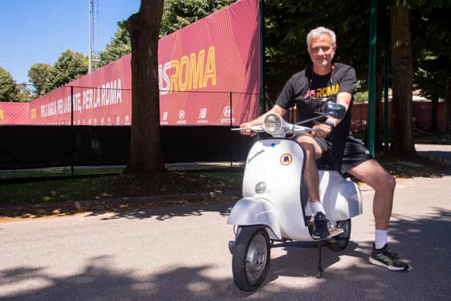 Mourinho rides a vespa after his arrival at the club.
