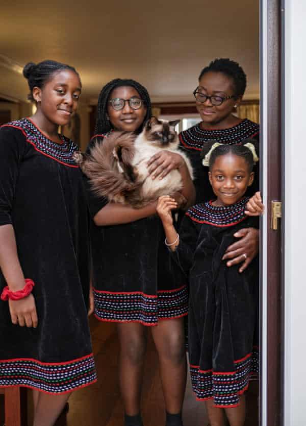 Ndah Tatani Mbawa, her three daughters and their cat, Zaki.