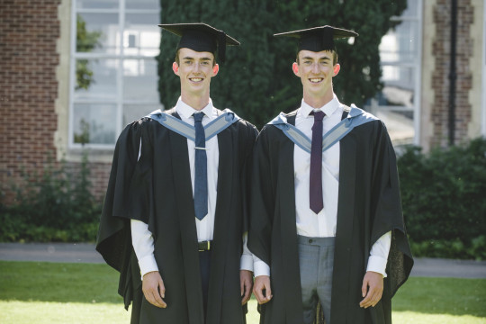 Adam and Jack Tremlett  in their caps and gowns on the day they both graduated and became doctors