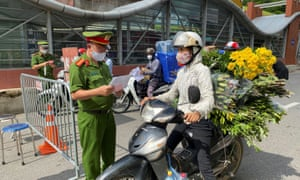 A commuter at a checkpoint in Hanoi earlier this month.