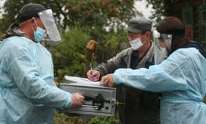 Electoral officials in PPE visit Ivanovka, a village in the Krapivinsky district of the Kemerovo region during early voting in the 2021 Russian legislative election.