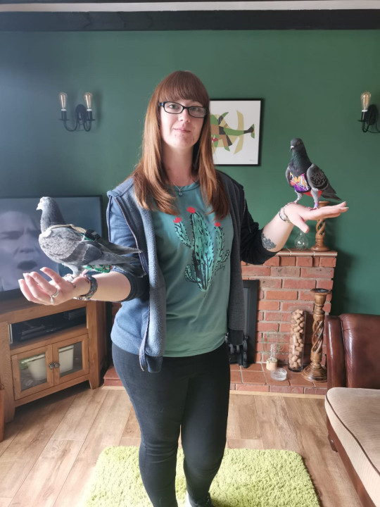MEGGY JOHNSON, 23, FROM LOUTH, LINCOLNSHIRE, WITH HER PET PIGEONS SKY AND MOOSE