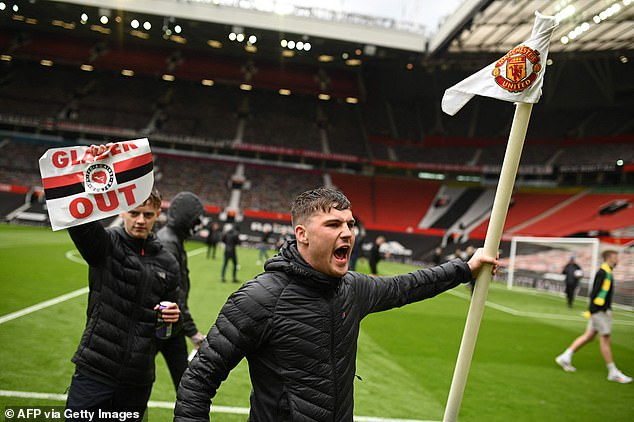 Furious United fans stormed the Old Trafford pitch in May, causing the postponement of a game against Liverpool, in protest at the club's owners and the European Super League