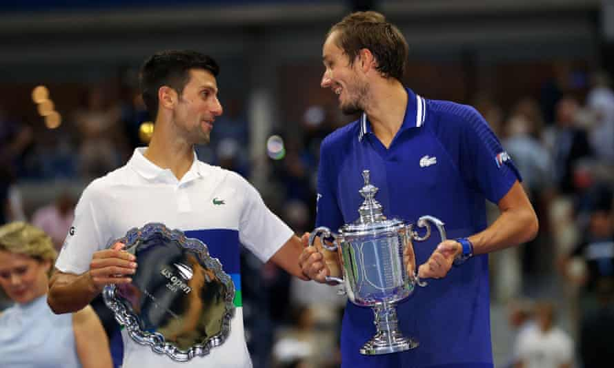 Novak Djokovic talks to the winner, Daniil Medvedev. The runner-up said he was 'the happiest man alive' after his ovation from the New York crowd.