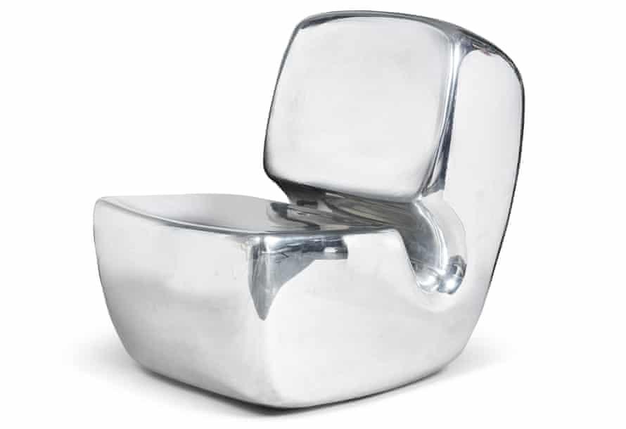A polished aluminium chair by Marc Newson