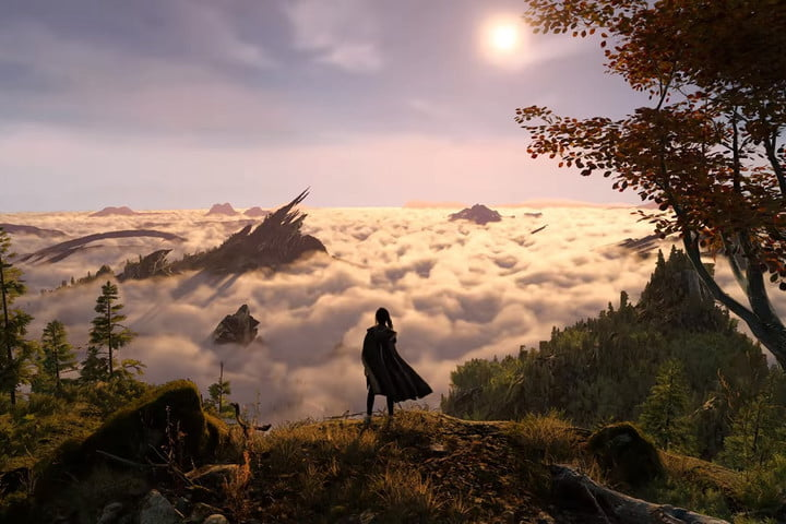 Frey stands on a cliff overlooking clouds.