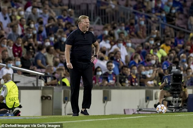 A 'Koeman Out' banner emerged at the Camp Nou on a bad night for manager Ronald (above)