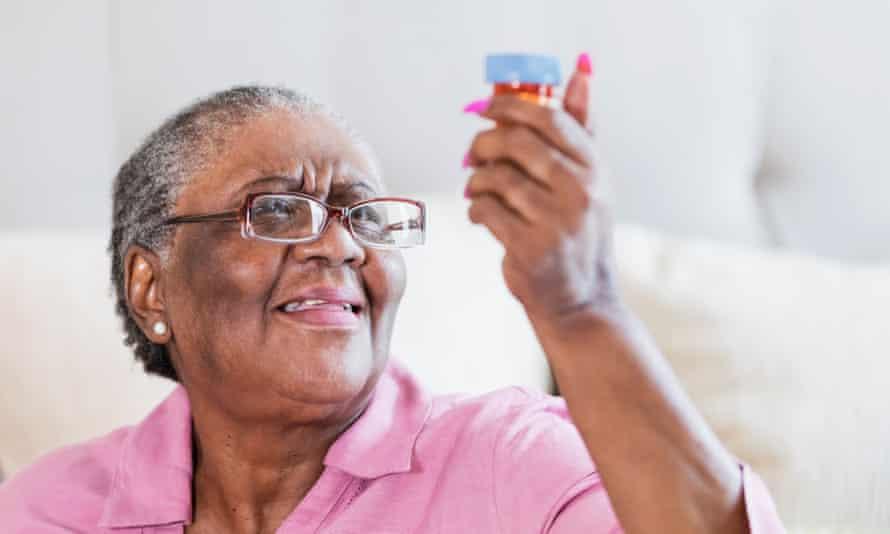 Senior African-American woman with prescription bottle