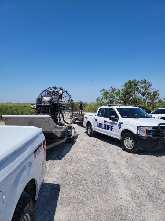 An airboat and truck used by the St. Tammany Parish Sheriff's Office in its search for the alligator believed to have killed a man after Hurricane Ida in Slidell, Louisiana.