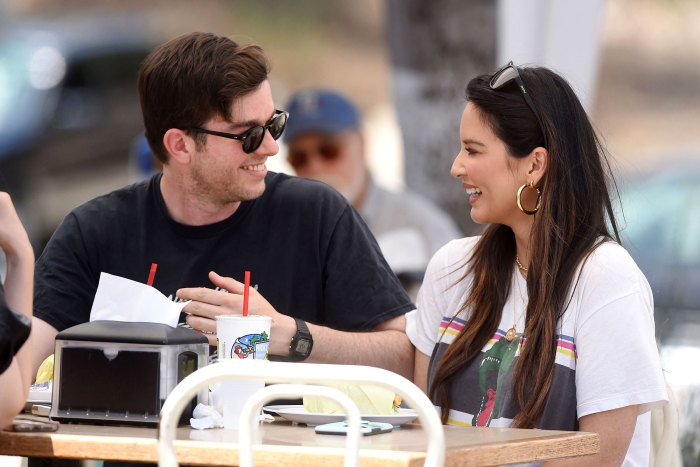 Pregnant Olivia Munn Shows Baby Bump Progress in New Photo With John Mulaney Eating Smile Sunglasses Hoop Earring