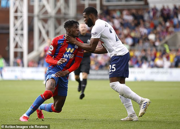 Japhet Tanganga (right) played centre back on Saturday but is suspended following a red card