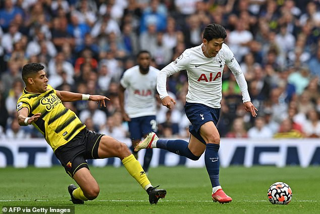 Heung-Min Son (right) is recovering from a calf injury with Spurs hopeful he can play Chelsea