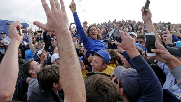 Tommy Fleetwood celebrates after winning the 2018 Ryder Cup in Paris. Photo: Tom Jenkins/The Guardian