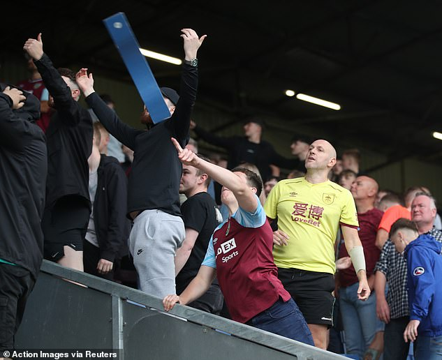 Burnley fans broke off parts of the wooden seats and hurled them towards the Arsenal fans