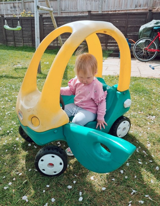 Vicki's youngest daughter, Wynne, in the car before
