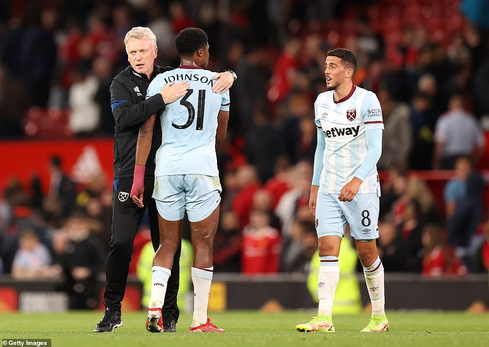 David Moyes congratulates his players at full-time as he earns his first win at Old Trafford since his own failed stint at the club