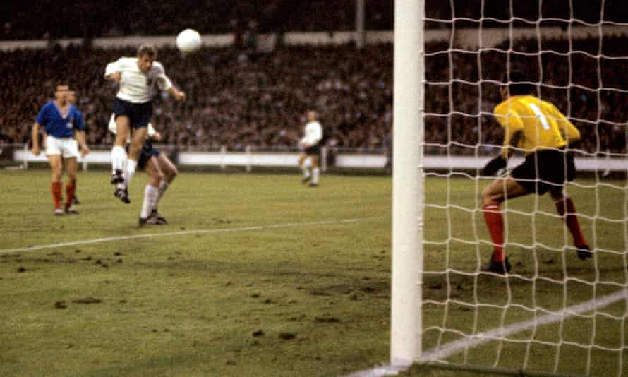 Roger Hunt heads home his, and England's, second goal past France's goalkeeper Marcel Aubour during their 1966 World Cup group game at Wembley.