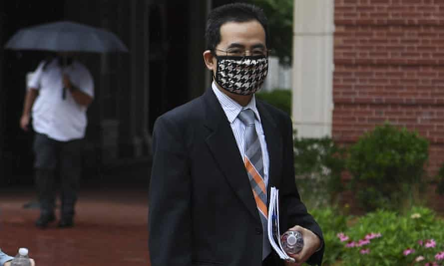 Anming Hu enters the Howard H. Baker, Jr. United States Courthouse in downtown Knoxville, Monday, June 7, 2021