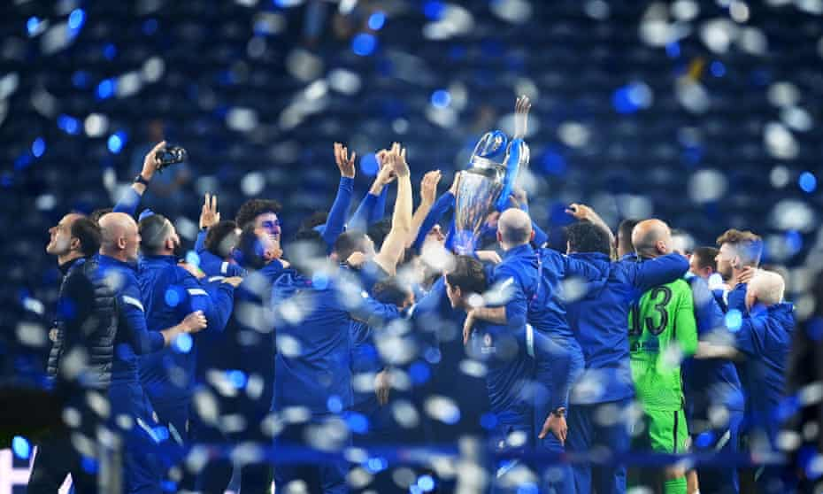 Thomas Tuchel (far left) takes a moment while his Chelsea players lift the Champions League trophy.