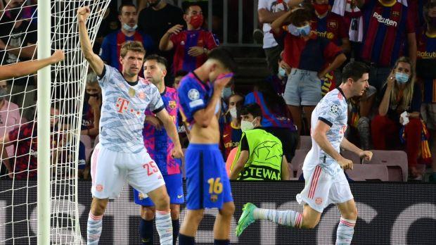 Bayern Munich forward Robert Lewandowski celebrates scoring a goal during the Champions League game against Barcelona at the Nou Camp. Photograph: Lluis Gene/AFP via Getty Images