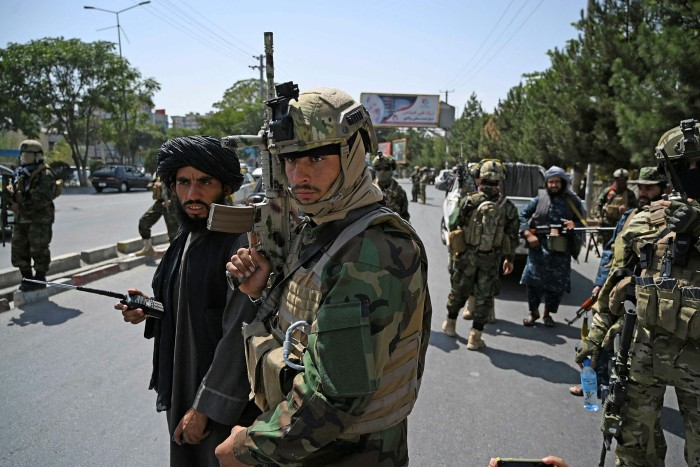 Taliban Fateh fighters, a 'special forces' unit, stand guard along a street in Kabul on August 29 2021