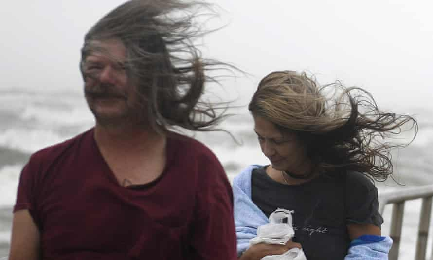 People's hair blows in the wind ahead of Tropical Storm Nicholas on Monday in Corpus Christi, Texas.