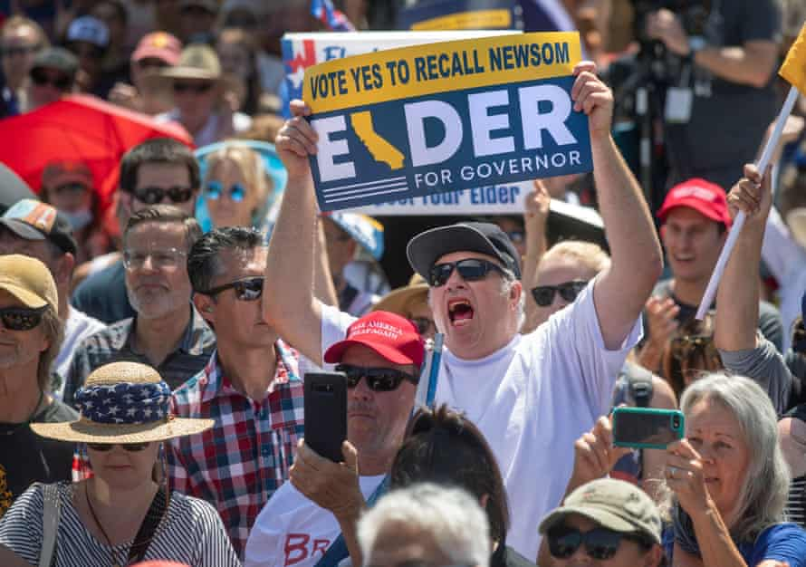 David Mead of Thousand Oaks, California, shows his support for Larry Elder at a rally on 6 September.