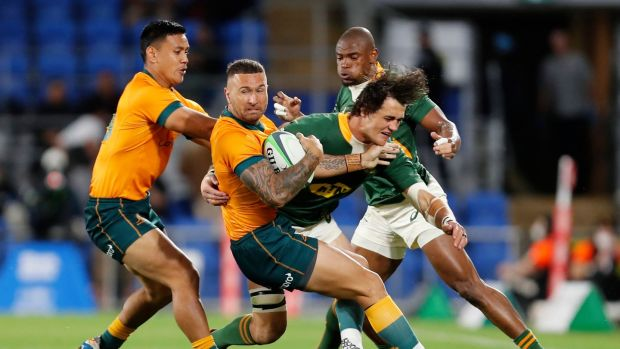 Australia's Quade Cooper attempts to spin out of a tackle from South Africa's Franco Mostert during the Rugby Championship match at Cbus Stadium on Australia's Gold Coast. Photograph: Regi Varghese/EPA