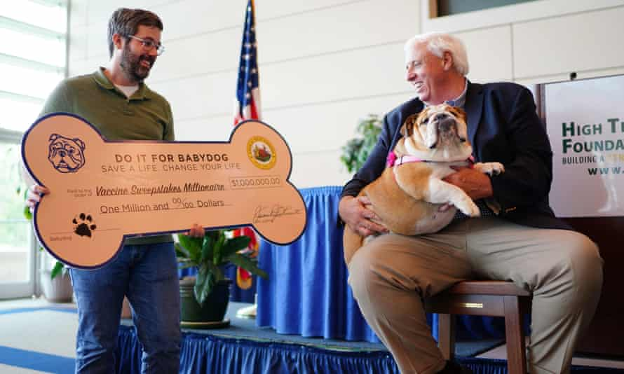 Governor Jim Justice presents Timothy Jackson, the latest million-dollar winner in West Virginia's vaccination sweepstakes, with a check on 14 July.