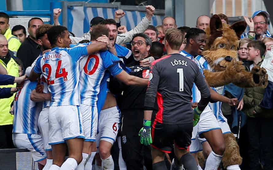 David Wagner celebrates with his Huddersfield players after a goal against Watford in April 2018